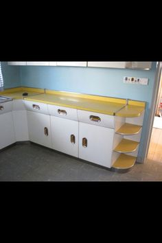 This is the English Rose Kitchen that I bought - in its original location. The kitchen layout will be different in my place and I've resprayed the doors. It's a work in progress...