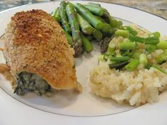 With Blonde Ambition: Spinach Stuffed Chicken Breasts  4 chicken breasts 1 pkg frozen chopped spinach (thawed and drained) 4 oz softened cream cheese 1/2 cup shredded mozzarella 4 Tbsp panko bread crumbs 1/2 to 3/4 tsp Cajun seasoning