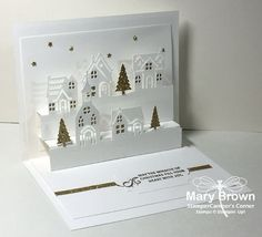 inside view of pop-up Christmas card from StamperCamper's Corner ... die cut winter village on two steps ... white and gold ... luv it! ... created by Mary Brown ...