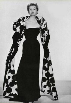 Model wearing a Dior evening gown and wrap, 1953.