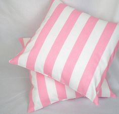 Pink striped cushions.