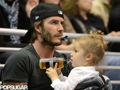 David Beckham holds on to little Harper (and her pacifier!)