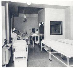 Nurses tending infants in the newborn nursery of the Jewish Hospital of St. Louis, 1927.