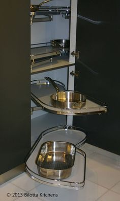 Le Mans pull-outs for easy access to pots and pans hidden deep in a corner cabinet.