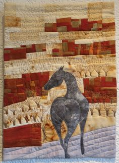 """Clos Grenache"" by Patricia Fuentes. Piecing and fusing appliqué. Some of the fabrics are dyed with rust using horseshoes and nails. Annual meeting of France Patchwork Swiss division 2015; photo by Sophie Zaugg"