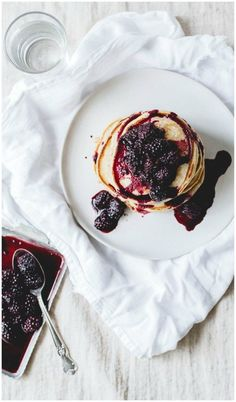 Lemon Ricotta Pancakes with Blackberry Syrup! These Pancakes are light with lots of lemon ricotta flavor! | http://WholeYum.com