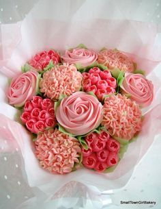 Pretty in pink cupcake bouquet with Roses and rose buds.