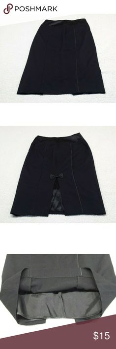 H&M Black Skirt size 4 H&M black skirt size 4 Opening in the lower behind with a decorative bow H.M Skirts Midi
