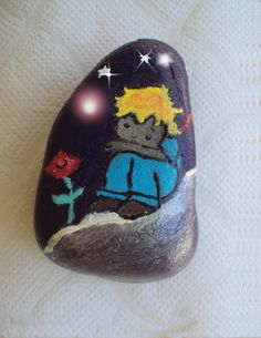 Principito  pintado a mano sobre piedra.