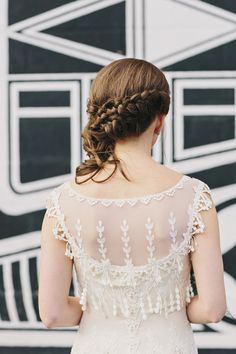 Claire Pettibone + braided hairdo, photo by Clean Plate Pictures http://ruffledblog.com/romantic-brooklyn-winery-wedding #hair #clairepettibone #bridal