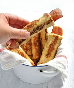 Bacon French Toast Roll Ups - crispy bacon rolled up in bread, dipped in egg mixture and pan fried golden brown. These need to be made with fresh, plain sandwich bread, not fancy artisan bread. #breakfast #brunch #french_toast #bacon #roll_up