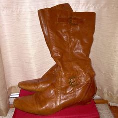 Bandolino Boots Beautiful light brown zip up boots. Only worn a handful of times. Has a small heel and are very comfortable. The only flaws are a little rubbing on the back and on the inside near zippers. Unsure if these are real leather. Bandolino Shoes Heeled Boots