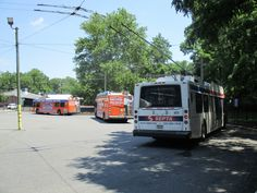 SEPTA New Flyer buses and trackless trolley at City Line Loop.