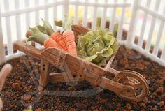 Gum paste carrots in a gum paste wagon