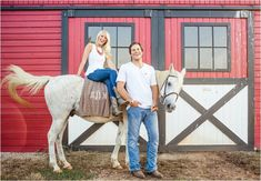 Farm engagement photos with horses and a red barn. Click to view more photos!