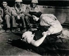 Flight nurse Jane Kendeigh, US Navy, caring for wounded Marine, William J Wycoff on Iwo Jima, March 3, 1945. Cheverton achieved the distinction of being the first flight nurse to land on a battlefield during World War II.