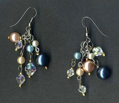 Earrings made from faux pearl beads, crystal beads and seed beads recycled from thrift store jewelry.