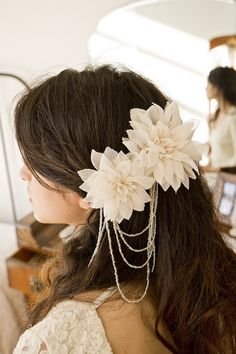 Bridal hair flowers attached to hair combs with dangling glass seed beads