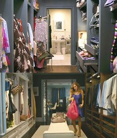 Carrie Bradshaw from Sex in the City's Closet. Fictional character Carrie Bradshaw's walk in closet as seen on the TV series Sex and the City.