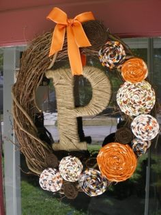 Fall wreath for the front door. Like the idea of wrapping the letter in yarn or some other material and attaching it with a ribbon instead of gluing it on.