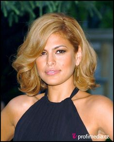 Eva Mendes - a great example of an olive-skinned latina going blonde. Note that she keeps the level a little lower and goes for a cool/honey mix that is neither too warm nor too cool. Suits her well!