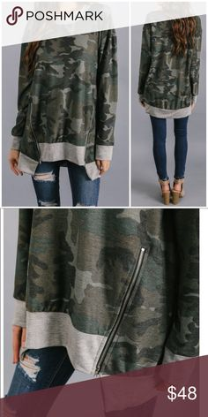 Camo Knit Zipper Long Sleeve Top Super casual cool with a relaxed fit. Long sleeves and gray contrast edging. Diagonal bottom zippers at hem. Soft comfortable knit material.    90% Polyester, 7% Rayon & 3% Spandex   * Please note - This top is pre-order and will ship in approx. a week * Tops