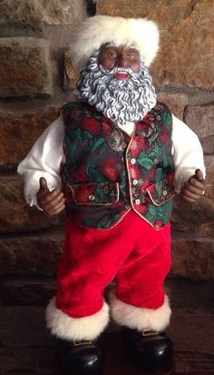 "Rockin Around the Christmas tree with this 1999  African American Black Animated Santa He's 16"" tall and comes with an AC Adapter  $49.09 on sale"