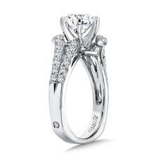 Double ribbons of diamonds split and gently curve to bypass and accent the center stone.