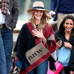 Rosie Huntington Whiteley in a Burbery cape. perfect travel outfit