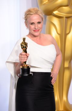 """Description of . Patricia Arquette poses backstage with the Oscar for best Actress in a Supporting Role for """"Boyhood"""" at the 87th Academy Awards on Sunday, Feb. 22, 2015. (Photo by David Crane / Los Angeles Daily News)"""