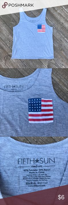 American Flag Pocket Tank Top This is a very simple yet cute tank top with a mini American Flag 🇺🇸 on the pocket. This top is in excellent condition EUC with no imperfections. Tag says medium, could likely fit XS-M with differing fit (a medium would fit this a bit tighter but an XS could probably still pull this off!!!). Feel free to ask any questions or make an offer. Notice: I reuse packaging to reduce waste💖🌷🌎! Fifth Sun Tops Tank Tops