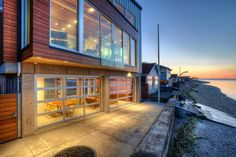 Architect Dan Nelson customizes garage doors for Pacific Northwest clients, creating flexible spaces for entertaining.  $13000 for 3 doors of insulated glass from Overhead Door.