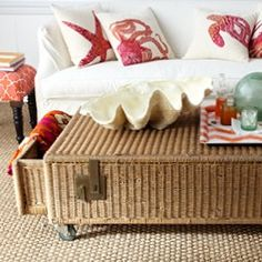 antique wicker trunk wheels added for versatility as a coffee