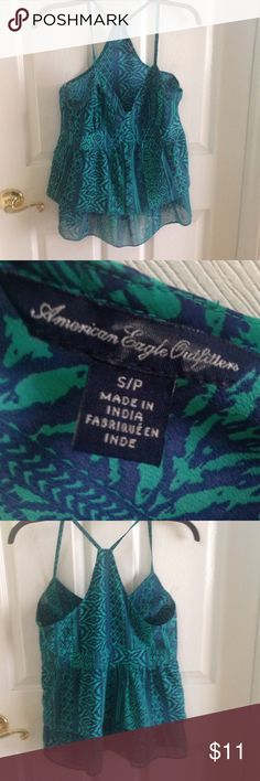 Tank summer top- beautiful- American Eagle Perfect Blue and green very nice polyester American Eagle dress tank blouse.  Back is a little lower than in front.  Beautiful top perfect for summer.  This top is absolutely gorgeous! American Eagle Outfitters Tops Tank Tops