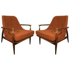 vintage pair of Ib Kofod Larsen style armchairs with brass arm-joint detail and original orange upholstery
