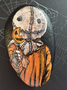 Sam from Trick 'r Treat.  Painted rock art