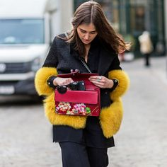 Yellow fur jacket and red floral clutch outfit