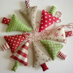 fabric christmas trees - reminds me of the ornaments we made when I was a little girl Fabric Christmas Trees, Christmas Tree Garland, Felt Christmas Decorations, Noel Christmas, Xmas Ornaments, Tree Decorations, Kirstie's Homemade Christmas, Christmas Material, Xmas Trees