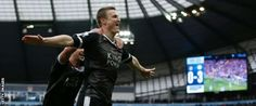 Leicester defender Robert Huth celebrates his second goal