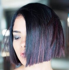 black blunt chin-length bob with dark burgundy highlights