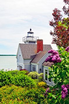 This week, we can't get enough of this unbelievably charming lighthouse for sale in Goetzville, Michigan. Yes, you read that correctly - a lighthouse. Sitting pretty on the St. Cottages By The Sea, Beach Cottages, Lighthouse For Sale, Playa Beach, House By The Sea, Beach House Decor, Coastal Living, My Dream Home, Dream Homes