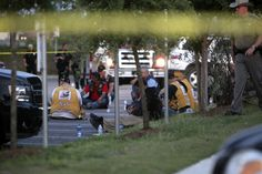 Police detain and watch members of various motorcycle clubs outside the Twin Peaks restaurant in Waco, Texas, Sunday, May 17, 2015. A shootout among rival motorcycle gangs at a popular Texas restaurant left nine bikers dead and more than a dozen injured, a police spokesman said Sunday. (AP Photo/John L. Mone)