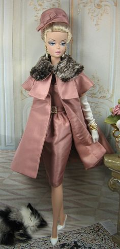 This Barbie is awesome!  I want to try making doll clothes with our Vintage Taffeta. http://www.ribbonjar.com/product_p/17527.htm