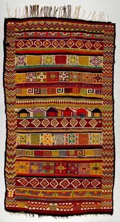 Africa | Floor rug from Gafsa, Tunisia | ca. 1930 - 1950 | Wool; weft-faced, interlocking tapestry woven. | Kilims from Gafsa in central Tunisia are famous for their brightly coloured, bold geometric patterns arranged in panels and executed in the interlocking-tapestry weave. Weavers of the plains of Tunisia favoured bright oranges, greens and blues, which were achieved with chemical dyes starting in the late 1800s. In more remote areas, chemical dyes were often combined with natural…