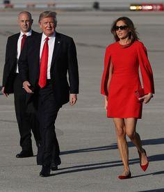 Melania Trump Photos Photos - U.S. President Donald Trump walks with his  wife Melania Trump on 026f3c800ba