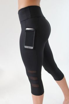 These sleek compression capris have a low-profile mesh detail that enhance breathability and modern style.  Fit and Product Details 2 side mesh pockets; fits most phones perfectly (iPhone 5, 6, 6+, Galaxy S7) Hidden key pocket on waistband Breathable crotch gusset Tagless Customers have been satisfied sizing up  Extra Small: 0-2 Small: 4-6 Medium: 8-10 Large: 12-14 Extra Large: 16 In between sizes? Size up.  Fabric and Care Nylon/Spandex, mesh detail on pocket and leg Lightweight, br...
