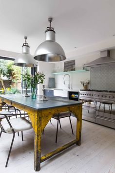 industrial kitchen with yellow table details at a Victorian house located in the London Borough of Fulham