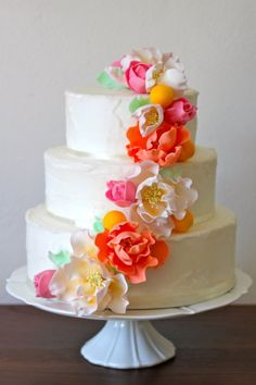 Oh, the colors! Gorgeous buttercream wedding cake with coral, yellow and pink poppies