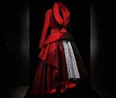 Inspired by the illustrations of René Gruau, a leading graphic designer of the 1940s and 1950s, this was part of the last and most technically challenging collection by John Galliano for Christian Dior. It took 500 hours to create this dress.  This dress is currently on display at the ROM in the History of Textiles/Fashion exhibit. I went there myself and saw this dress. It was a lot more impressive seeing it on a person than the display.