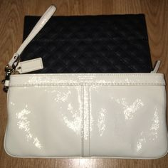 White Coach Wristlet Large patent white coach wristlet. Item is well loved and has typical signs of wear. Small stain in inside pocket and corner wear.  Top portion is slightly off color. See photos for reference. Since it's a large wristlet you can easily fit keys, phone, cards, cash and a few makeup items. Coach Bags Clutches & Wristlets